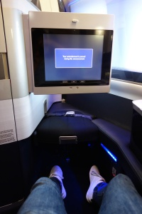 Footrest with seatbelt and in-flight entertainment