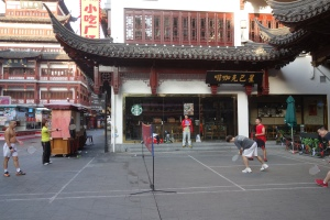 One of my favorite sites from Shanghai: badminton in front of Starbucks