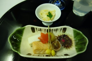 Squid with sea urchin, and selection of seasonal morsels (squid in soy sauce, salmon, dried persimmon in ham, fishcake with beans, chestnut compote, gingko nuts, and red pimiento)
