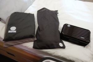 Van Laack pajamas and Rimowa amenity kit