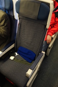 Economy seat with a hard shell